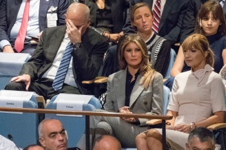 White House Chief of Staff John Kelly, left, reacts as he and First Lady Melania Trump listens as U.S. President Donald Trump speaks during the 72nd session of the United Nations General Assembly at U.N. headquarters, Tuesday, Sept. 19, 2017. (AP Photo/Mary Altaffer)